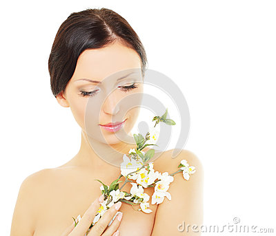 Woman with spring blossom, spa concept
