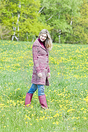 Woman on spring meadow