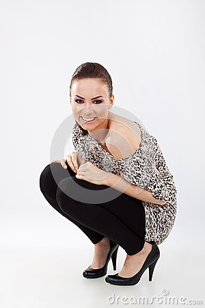 Woman in squat position smiling