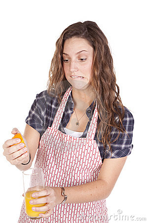 Woman Squeezing Orange Juice Hard Royalty Free Stock Photo - Image: 16925245
