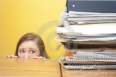 Woman stairing fearfully at files