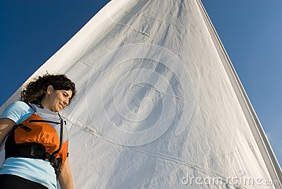 Woman Standing Against Sail on Boat - Horizontal