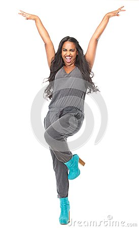 Woman standing with arms raised and happy expression