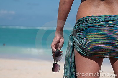 Woman standing back with tied pareo on the loins