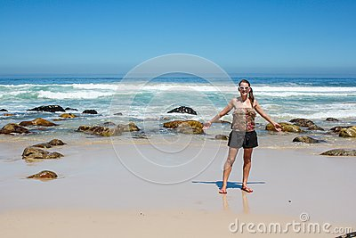 Woman standing at a beach