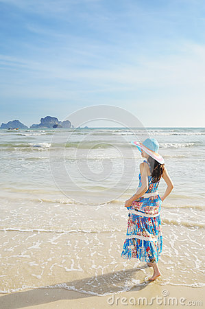 Woman standing on the beach in Krabi Thailand