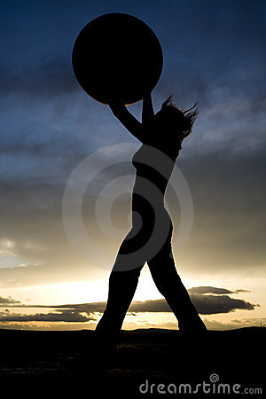 Woman standing with big ball silhouette