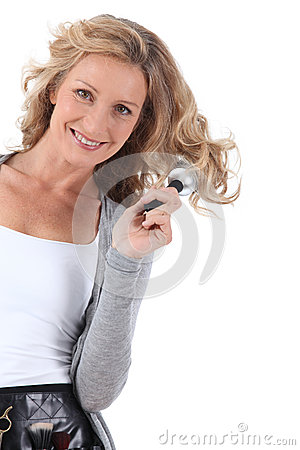 Woman standing brushing hair