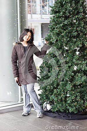 Woman standing by christmas tree at convention center