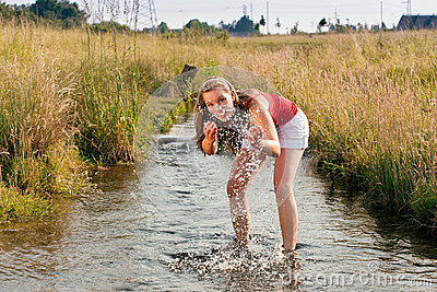Woman standing in creek summer