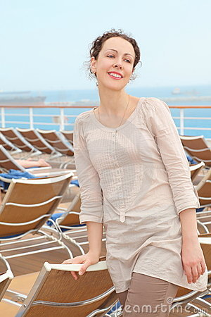 Woman standing on deck of cruise ship