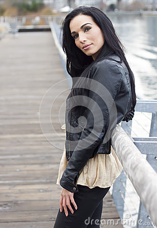 Woman standing at dockside smiling