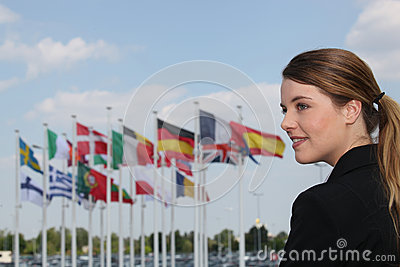 Woman standing by flags