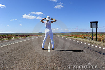 Woman Standing on Highway