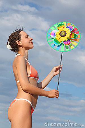 Woman standing and holding pinwheel toy