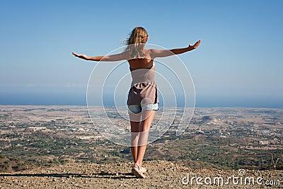 woman-standing-on-a-mountain-top-thumb16240141Girl Standing On Top Of A Mountain