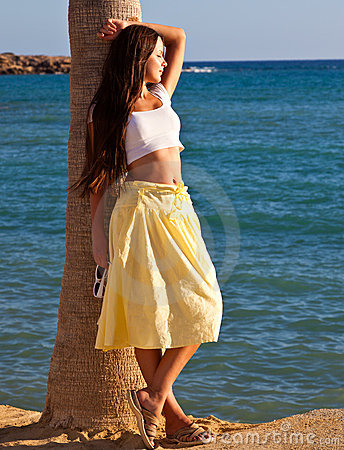 Woman Is Standing Near The Palm Tree Stock Photo - Image: 16277040