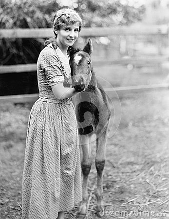 Free Woman Standing Next To A Pony In A Corral Stock Photo - 52029580