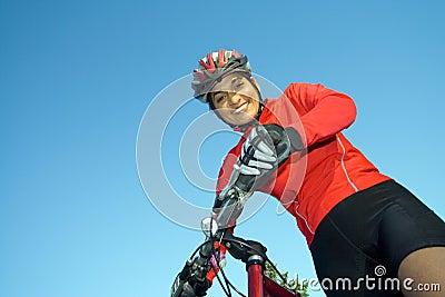Woman Standing Next to Bicycle - Horizontal