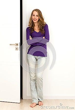 Woman standing next to door