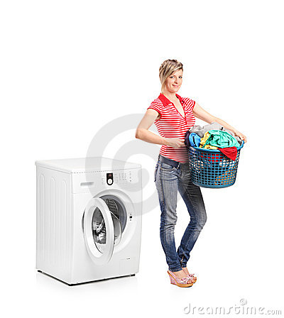 Woman standing next to a washing machine