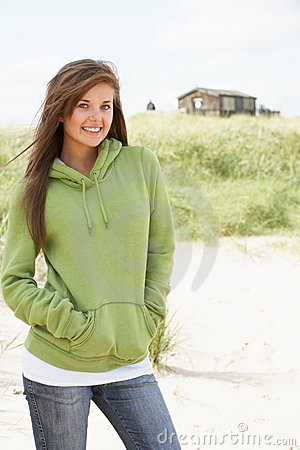 Free Woman Standing On Beach Wearing Hooded Top Stock Image - 13673261