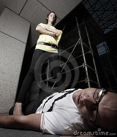 Free Woman Standing Over A Defeated Man Stock Images - 10838934