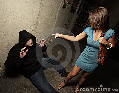 Woman standing over the robber