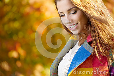 Woman standing in a park in autumn