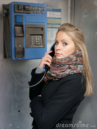 Woman standing at phonebox