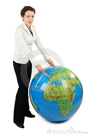 Woman standing and pointing at Europe on globe