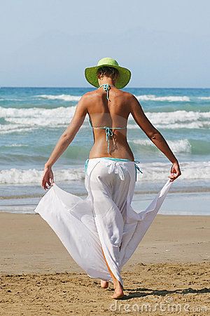 Woman standing on shoreline at the beach