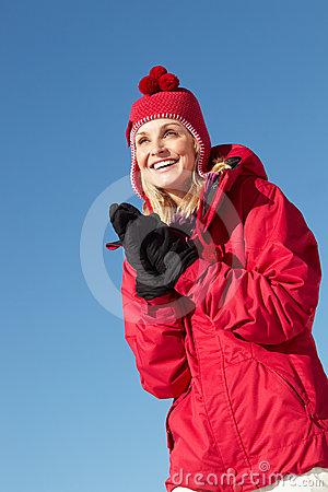 Woman Standing In Snow On Ski Holiday