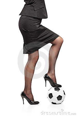 Woman standing on a soccer ball
