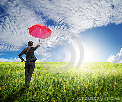 Woman standing to blue sky  with red umbrella