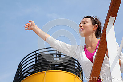 Woman stands on board of large ship