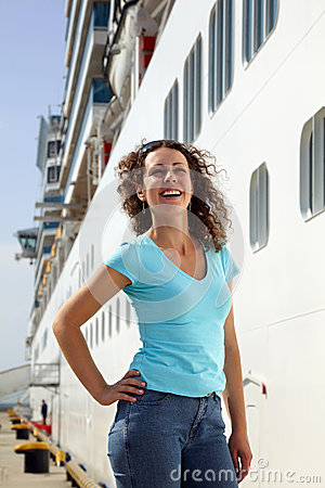 Woman stands near board of multideck ship