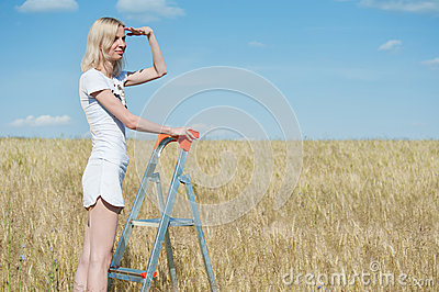 Woman stands on the stepladder