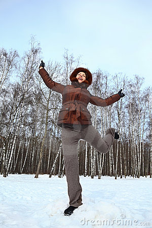 Woman stands on to snow and gravitate skyward