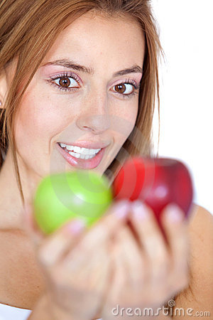 Woman staring at two apples