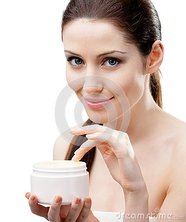 Woman starting to apply mask