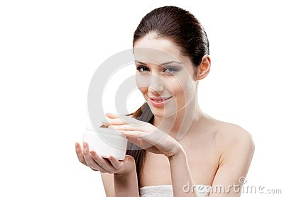 Woman starting to apply moisturizer