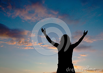 Woman staying with raised hands
