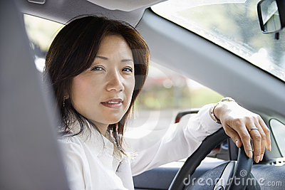 Woman at steering wheel