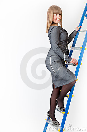 A woman on a stepladder