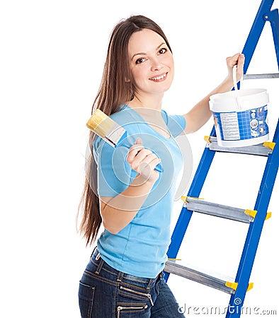 A woman on a stepladder