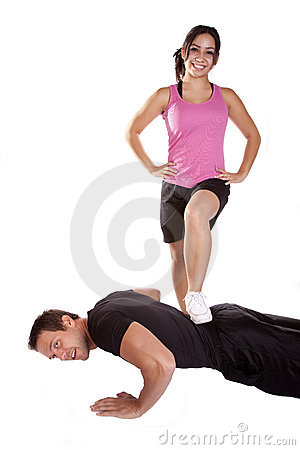 Woman stepping on man pushups