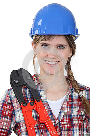 Woman stood holding  tool