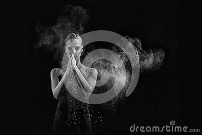 Woman With Stop Motion of Explosive Powder Captured by Flash