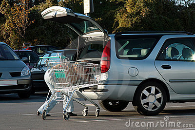 Woman storing purchase in the car